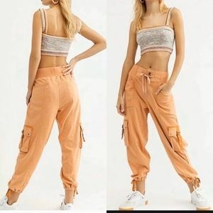 NWT! Free People orange semi- charmed joggers XS